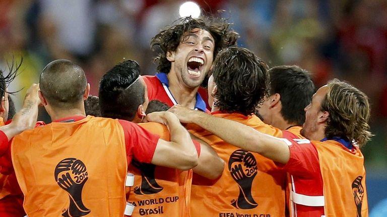 Chile's Jorge Valdivia, top center, celebrates after scoring