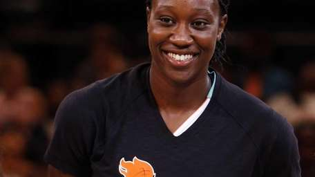 Liberty's Tina Charles accepts the NBA Cares State