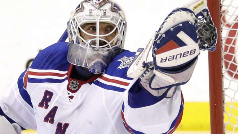 Rangers goalie Henrik Lundqvist gloves the puck while