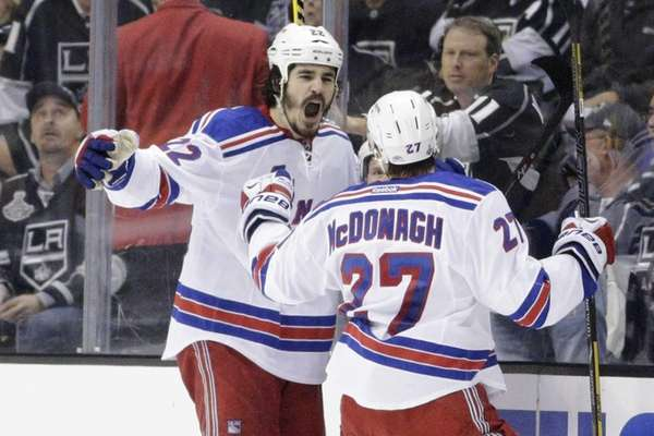Rangers center Brian Boyle, left, reacts with teammate