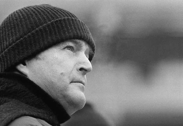 Pittsburgh Steelers coach Chuck Noll glances toward the