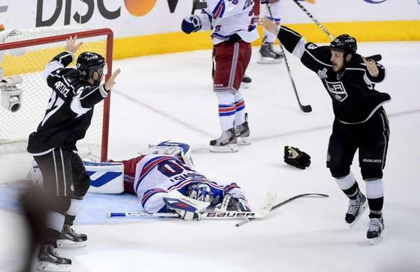 Los Angeles Kings defenseman Alec Martinez, left, celebrates