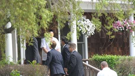 House Majority Leader Eric Cantor (center glasses) arrives