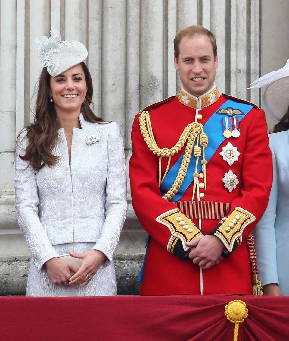 Prince William and Kate stand on the balcony