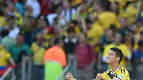 Colombia's midfielder James Rodriguez celebrates after scoring his