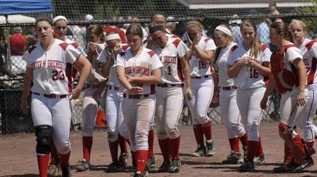 Center Moriches players react after a 4-3 loss