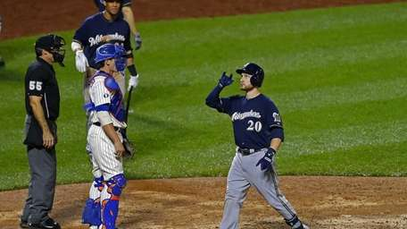 Jonathan Lucroy of the Milwaukee Brewers gestures after