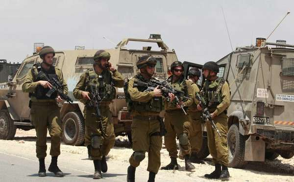 Israeli soldiers deploy near the West Bank city