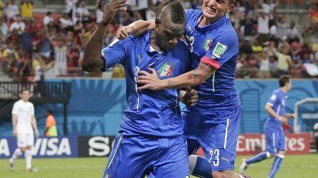 Italy's Mario Balotelli celebrates with Italy's Marco Verratti