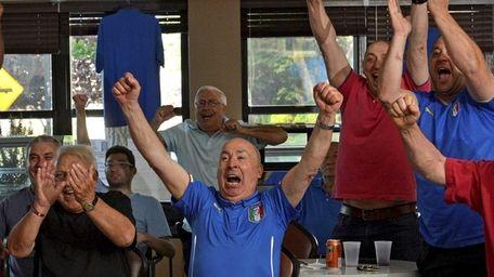 Vito Dabrosao, center, celebrates with friends at the