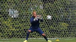 Goalkeeper Tim Howard of the United States runs