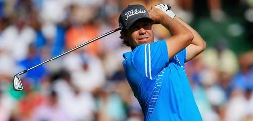 Erik Compton hits his tee shot on the