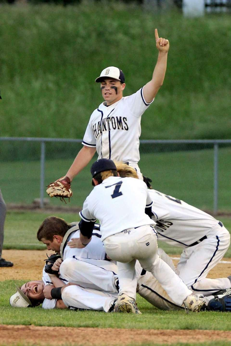 Bayport-Blue Point pitcher PJ Weeks, bottom left, gets