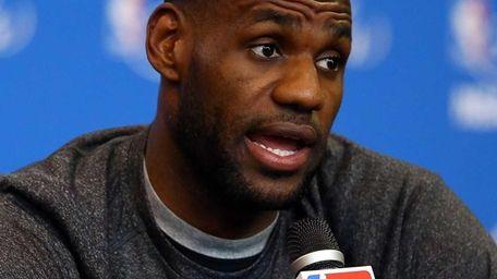 LeBron James of the Miami Heat speaks to