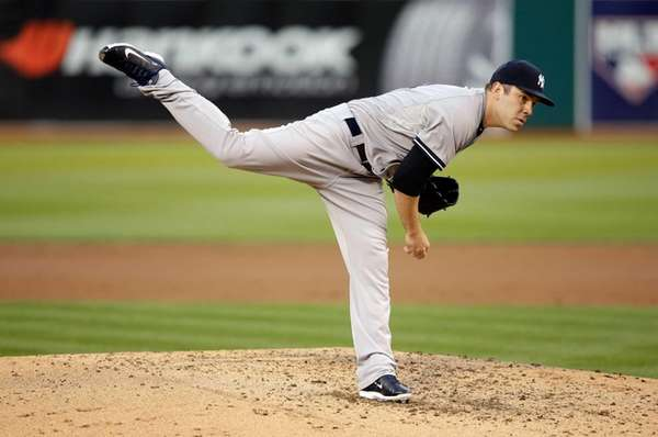 David Phelps of the Yankees pitches against the