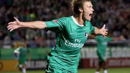 The Cosmos' Mads Stokkelien celebrates his second goal