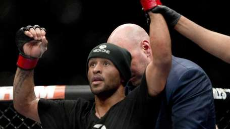 Demetrious Johnson, of the United States, celebrates his