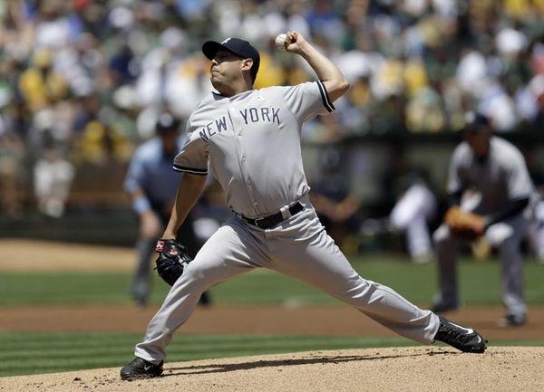 Yankees' Vidal Nuno works against the Oakland Athletics