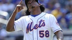 Mets pitcher Jenrry Mejia reacts at the end