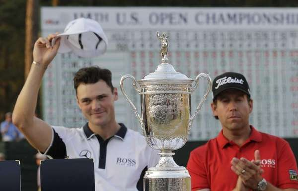 Martin Kaymer, of Germany, left, and Erik Compton