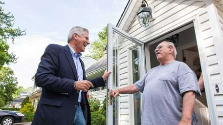 Congressional candidate Bruce Blakeman speaks to Robert Cipriano