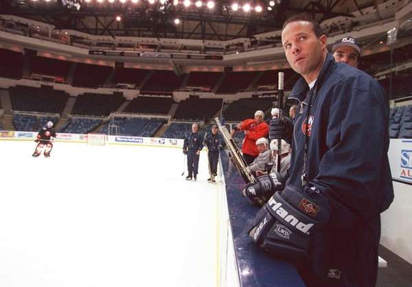 Islanders' coach Greg Cronin watches players practice Tuesday,