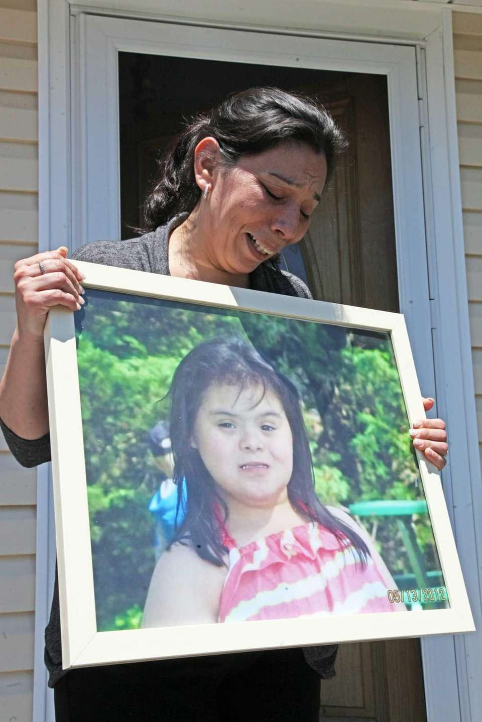 Jennifer Curuchaga holds a picture of her daughter