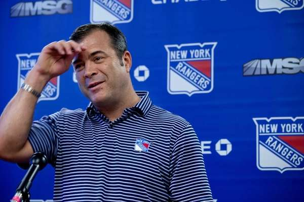 Rangers head coach Alain Vigneault smiles during a