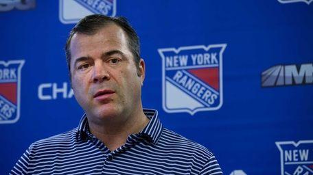 Rangers head coach Alain Vigneault answers a question