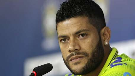 Brazil's Hulk listens to questions from the media