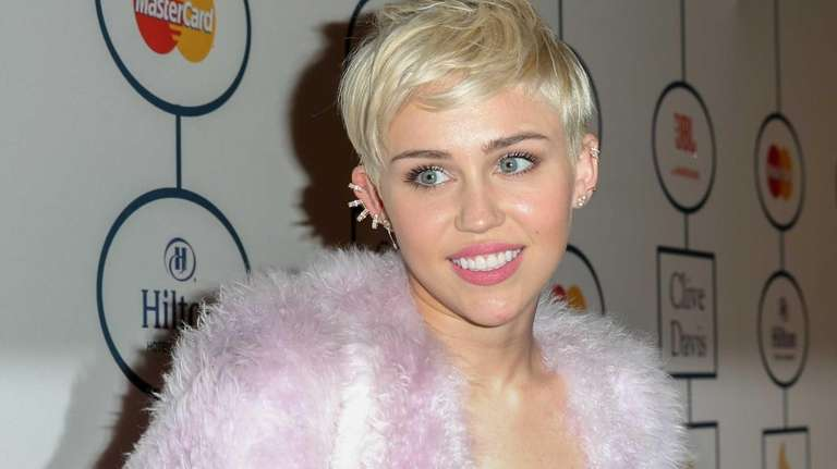 Singer Miley Cyrus arrives at a pre-Grammys gala