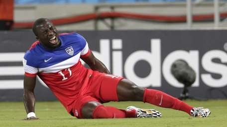 The United States' Jozy Altidore grimaces after pulling