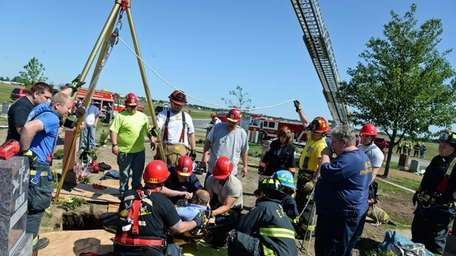 Firefighters rescue a man who fell into a