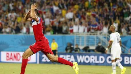 The United States' John Brooks reacts after scoring