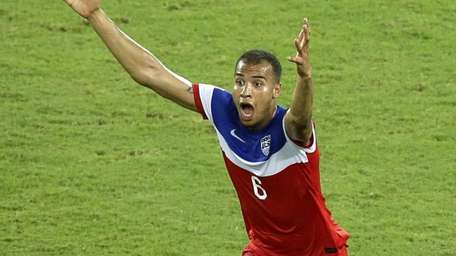 The United States' John Brooks celebrates scoring his
