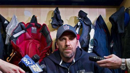 Rangers goalie Henrik Lundqvist speaks in the locker