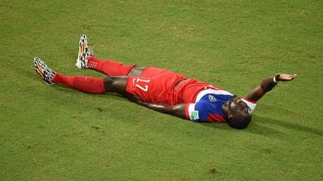USA forward Jozy Altidore gestures in pain during