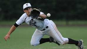 Suffolk shortstop Jesse Berardi of Commack dives to
