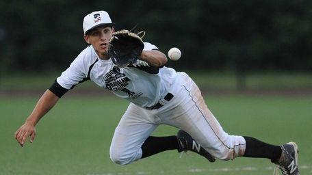 Suffolk shortstop Jesse Berardi of Commack dives to