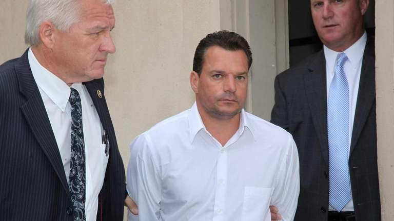 Michael Elardo, 48, of Syosset, leaves Nassau County