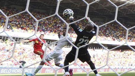 Belgium's Dries Mertens, left, scores his team's second
