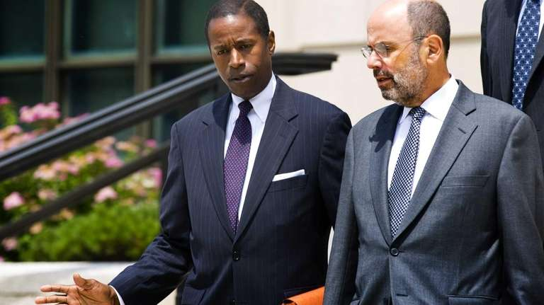Senator Malcolm Smith, left, walks out of federal