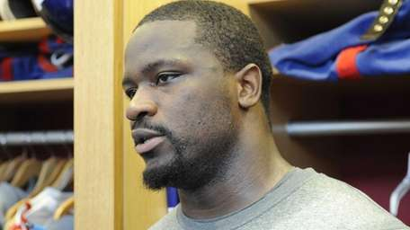 Giants linebacker Jameel McClain speaks to the press