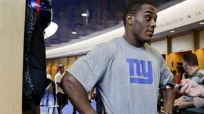 Giants linebacker Devon Kennard answers questions from the