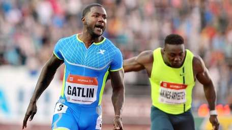 Justin Gatlin from USA, left, reacts as he