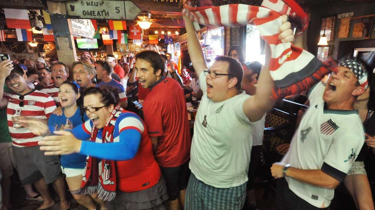 Soccer fans cheer before the World Cup match