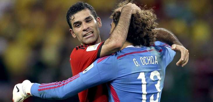 Mexico's Rafael Marquez, left, embraces Mexico's goalkeeper Guillermo