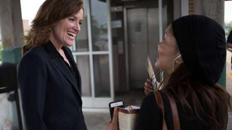 Congressional candidate Kathleen Rice greets commuters at the