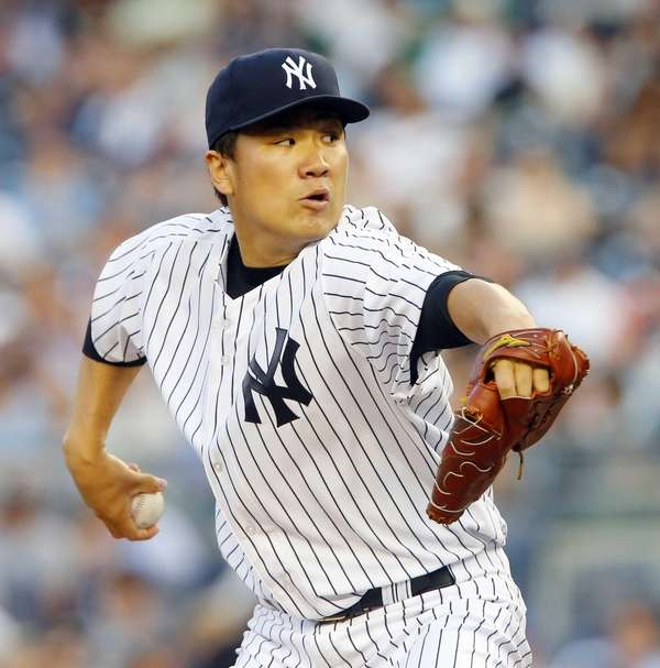 Masahiro Tanaka of the Yankees delivers a pitch