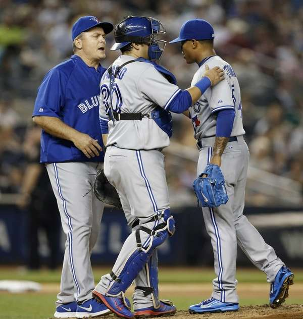 Toronto Blue Jays manager John Gibbons, far left,